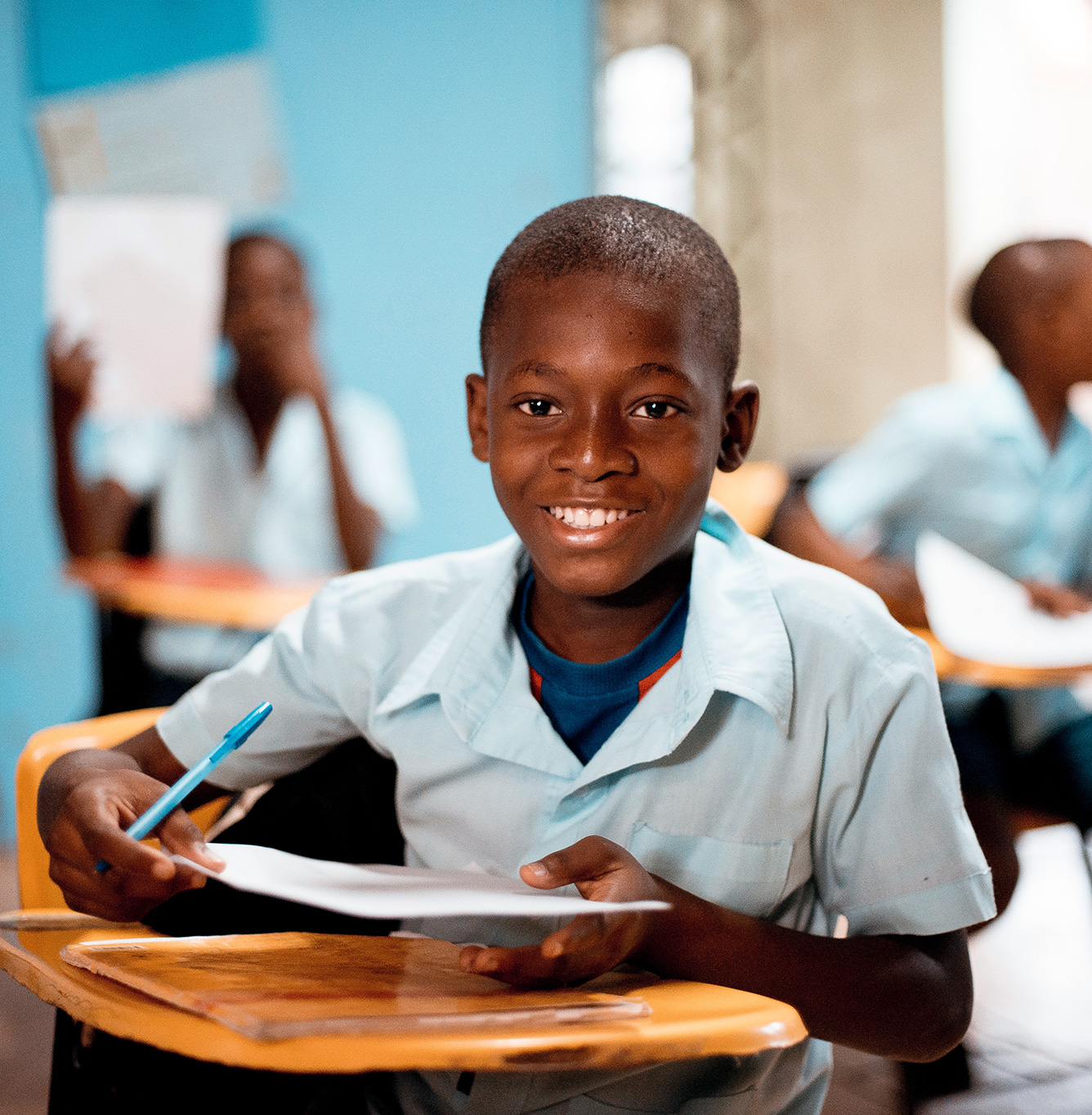 Happy Street Child student sitting in a classroom